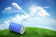 Composite image of high angle view of 3d solar power battery. High angle view of 3d solar power battery against green hill under blue sky Royalty Free Stock Photo