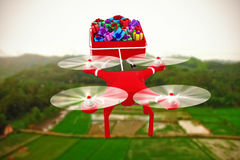 Composite image of high angle view of drone pulling chirstmas sledge Stock Image