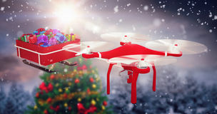 Composite image of high angle view of flying drone pulling chirstmas sledge Stock Photos