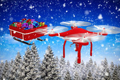 Composite image of high angle view of flying drone pulling chirstmas sledge Royalty Free Stock Photos