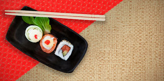 Composite image of high angle view of fresh sushi in plate Royalty Free Stock Photos