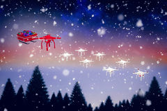 Composite image of high angle view of mini drone pulling chirstmas sledge Royalty Free Stock Photos
