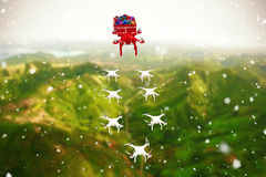 Composite image of high angle view of mini drone pulling chirstmas sledge with gift Royalty Free Stock Photography
