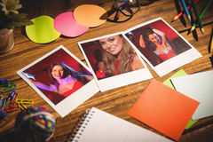 Composite image of high angle view of office supplies with blank instant photos Stock Photo