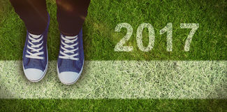 Composite image of high angle view of person wearing canvas shoes Royalty Free Stock Photos