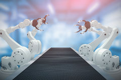 Composite image of high angle view of robot hand 3d Stock Image