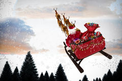 Composite image of high angle view of santa claus riding on sled during christmas. High angle view of Santa Claus riding on sled during Christmas against snow Stock Image