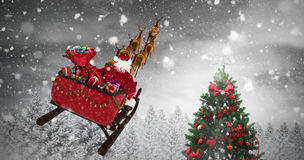 Composite image of high angle view of santa claus riding on sled during christmas Royalty Free Stock Photos