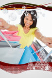 Composite image of highangle view of a young woman showing shopping bags Royalty Free Stock Photography