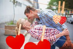 Composite image of hip romantic couple dancing in the street Royalty Free Stock Photography