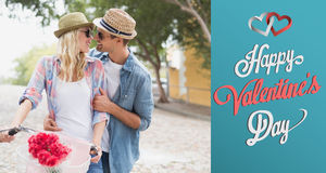 Composite image of hip young couple going for a bike ride Royalty Free Stock Images