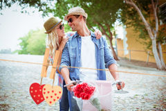 Composite image of hip young couple going for a bike ride Royalty Free Stock Photos