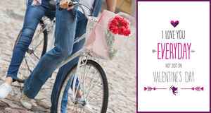 Composite image of hip young couple going for a bike ride. Hip young couple going for a bike ride against valentines day greeting stock images