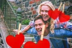 Composite image of hip young couple having fun Royalty Free Stock Photos