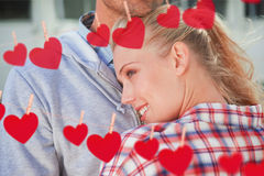 Composite image of hip young couple hugging each other Royalty Free Stock Image