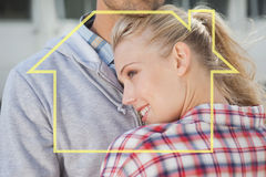 Composite image of hip young couple hugging each other Royalty Free Stock Photo