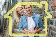 Composite image of hip young couple sitting on steps smiling at camera Stock Images