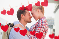 Composite image of hip young couple smiling at each other Royalty Free Stock Images