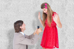 A Composite image of hipster on bended knee doing a marriage proposal to his girlfriend. Hipster on bended knee doing a marriage proposal to his girlfriend Stock Images