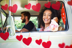Composite image of hipster couple driving in camper van Stock Images