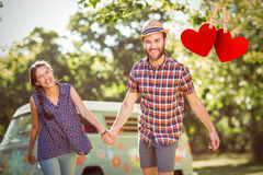 Composite image of hipster couple having fun together Royalty Free Stock Photos