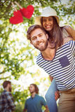 Composite image of hipster couple having fun together stock photography