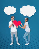 Composite image of hipster couple smiling at camera holding a heart Stock Photos
