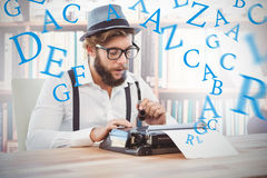 Composite image of hipster holding smoking pipe while working on typewriter Royalty Free Stock Photography