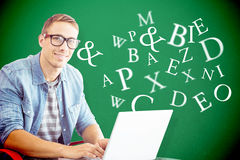 Composite image of hipster on laptop Stock Photos