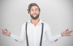 Composite image of hipster meditating arms outstretched Stock Photo