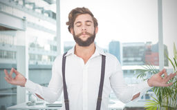 Composite image of hipster meditating arms outstretched Royalty Free Stock Image