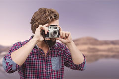 Composite image of hipster photographing with camera Stock Photos