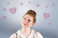 Composite image of hipster redhead looking up thinking Royalty Free Stock Image