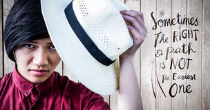 Composite image of hipster with a straw hat Royalty Free Stock Image