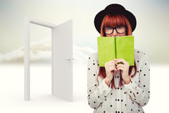 Composite image of hipster woman behind a green book Stock Photography