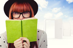Composite image of hipster woman behind a green book Stock Images