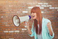 Composite image of hipster woman shooting through megaphone Stock Images