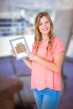 Composite image of hipster woman showing tablet pc Stock Photo