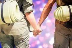Composite image of hitch hiking couple standing holding hands on the road Stock Photography