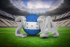 Composite image of honduras world cup 2014. Honduras world cup 2014 against vast football stadium with fans in white Royalty Free Stock Image