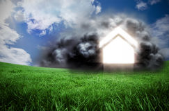 Composite image of house in cloud. Against green field under blue sky Royalty Free Stock Photos