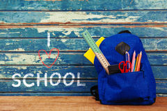 Composite image of i love school text on white background. I love school text on white background against school bag on table Stock Photography