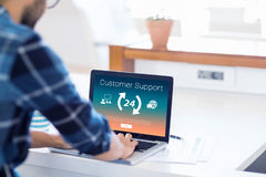 Composite image of icons with arrow symbols and customer support text. Icons with arrow symbols and customer support text against cropped image of businessman Stock Images