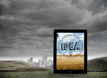 Composite image of idea graphic on tablet screen Royalty Free Stock Photo