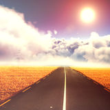 Composite image of idyllic view of sun over cloudscape during sunny day Stock Photos