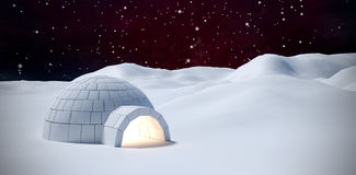 Composite image of igloo on snow field Royalty Free Stock Photography