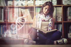 Composite image of illustration of dna. Illustration of DNA against female student against bookshelf reading a book on the library floor stock photography