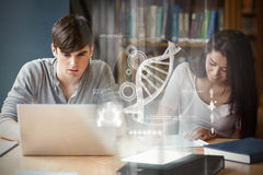 Composite image of illustration of dna. Illustration of DNA against students working together Stock Photo