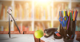 Composite image of illustration of drawing compass. Illustration of drawing compass against shelf of books Stock Photos