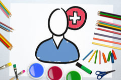 Composite image of illustration of surgeon against plus sign. Illustration of surgeon against plus sign against art supplies Stock Photo